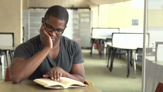 African American male reading book