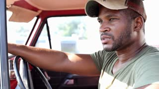 African american male sitting in pickup truck
