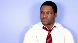 African American Male standing against blue background