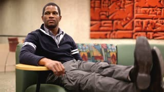 African American Student sitting on Couch