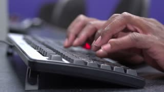 African male fingers on keyboard typing