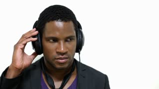 African Male listening to Headphones on White