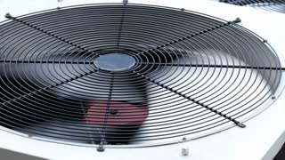 Air conditioner unit fan rotating