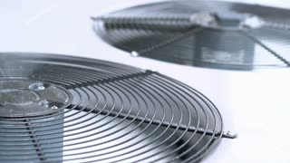 Air conditioner unit fans spinning