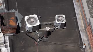 Air conditioner units on top of industrial building 4k