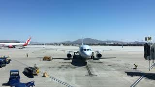 Airplane entering to deboard at terminal gate McCarran Airport 4k