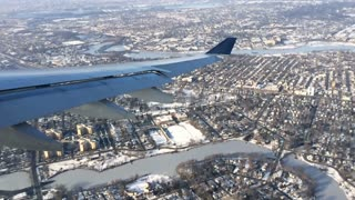 Airplane view of flight and city below slow motion 720p