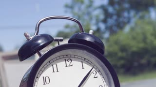 Alarm clock ringing in slow motion