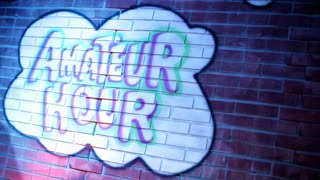 Amateur Hour Painted on Brick Wall left