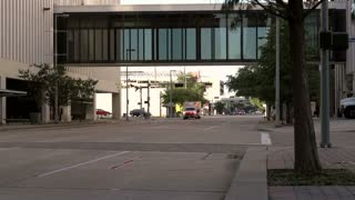 Ambulance goes by in downtown Houston