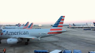 American Airlines airplanes lined up at terminal gates in Charlotte NC 4k
