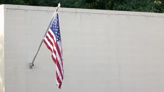 American Flag hanging on brick wall 4k
