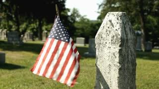 American flag in graveyard