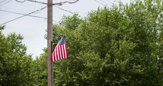 American Flag on telephone pole during July 4th 4k