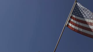 American flag posted outside of home along fence 4k