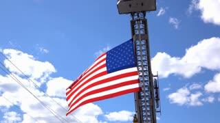 American flag waving on Firetruck ladder 4k