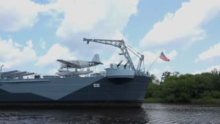 American flag waving on front of USS North Carolina Battleship 4k