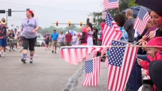 American flags waving on route of 4th of July Parade 4k