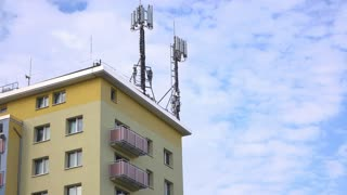 Apartment exterior shot with antenna on building top 4k