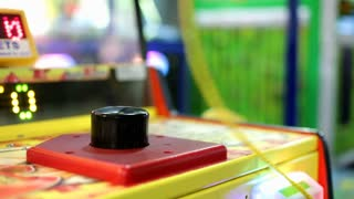 Arcade game with mallet hitting button