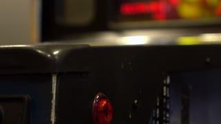 Arcade pinball machine played by girl 4k