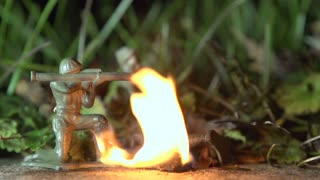 Army Men being hit with flame thrower