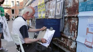 Artist painting in streets of Venice