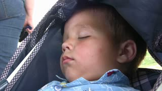 Baby Sleeping in Buggy