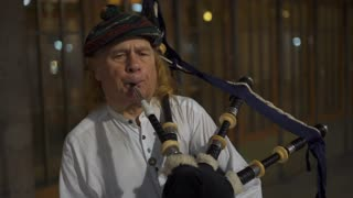 Bagpipe street entertainer playing at entrance to Grand Central Terminal NYC 4k
