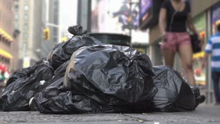 Bags of trash in city streets slow motion