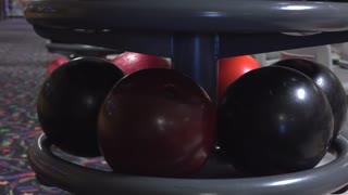 Ball rack pan to bowling alley