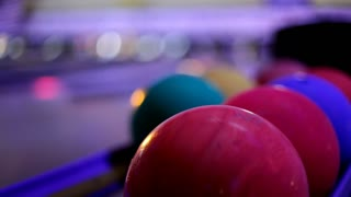Balls at bowling alley during midnight bowl
