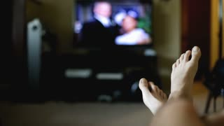 Bare Feet on Couch Watching TV