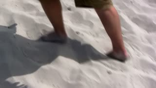 Bare Feet Walking through Sand