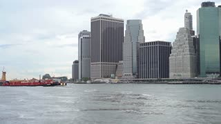 Barge entering East River in Manhattan area of New York City 4k