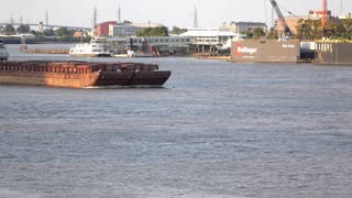 Barge floating by in New Orleans Mississippi river 4k