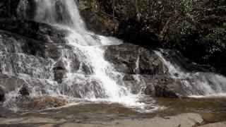 Beautiful waterfall in nature flowing down rocks 4k