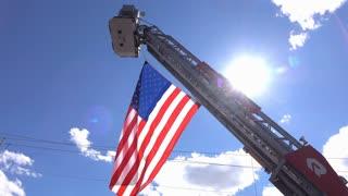 Beavercreek Township Firetruck ladder in air with American Flag 4k