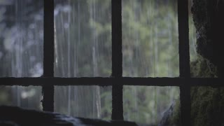 Behind medieval Prison bars with rain outside 4k