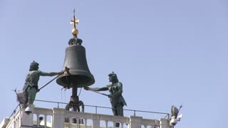 Bell ringing at top of tower in Venice Italy