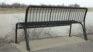 Bench next to flowing water