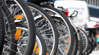 Bicycle rack with parked bikes in city 4k