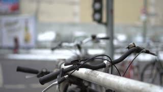 Bicycles against railing near street light
