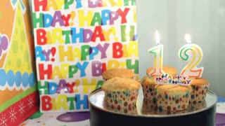 Birthday candles blown out age twelve