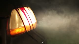 Blood dripping down headlight of car in fog