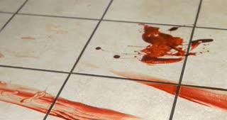 Blood pooled on kitchen floor tile 4k