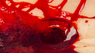 Blood washed out of sink with water slow motion