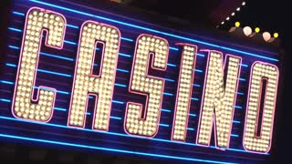 Blue Casino sign attracting customers and gamers 4k