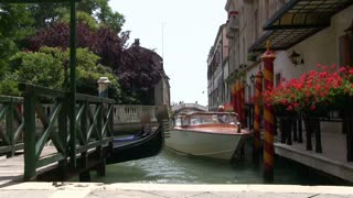 Boat docked in canal of Venice Italy