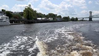 Boat driving by docks of Wilmington North Carolina